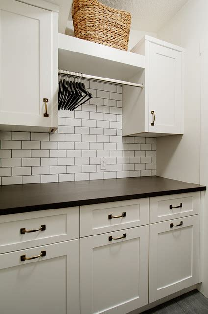 installation of kitchen cabinets laundry room contemporary laundry room calgary by 4725