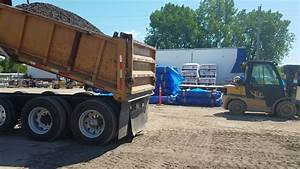 How to back spread gravel with a dump truck - YouTube