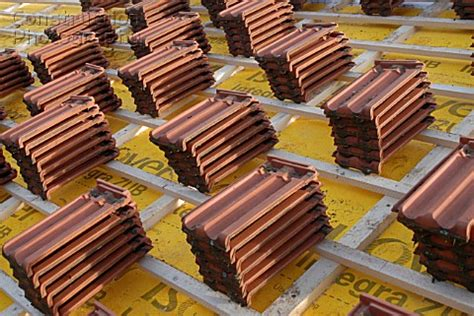 a168 00906 roofing tiles resting wooden roof slats a construction