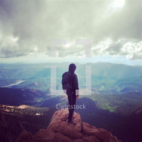 stock photo    man standing   mountain top