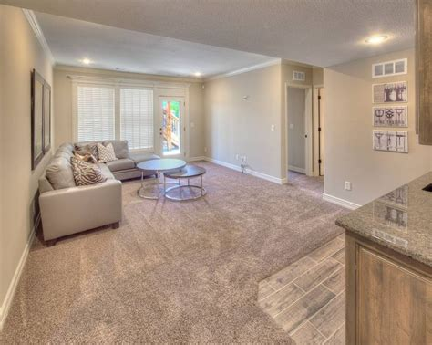 light neutral colors in the finished basement of the catania floor plan from summit custom homes