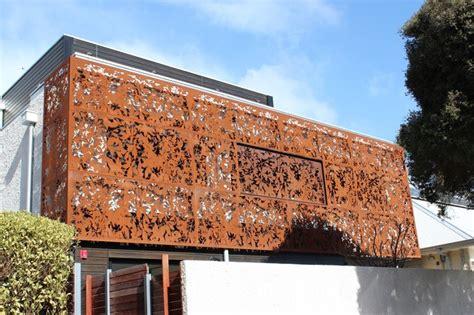corten laser cut screens  facade  metro