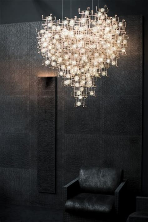 sculptural chandeliers accented  real dandelion seeds