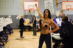 TOPLESS protesters chanting anti-Trump slogans had to be ...