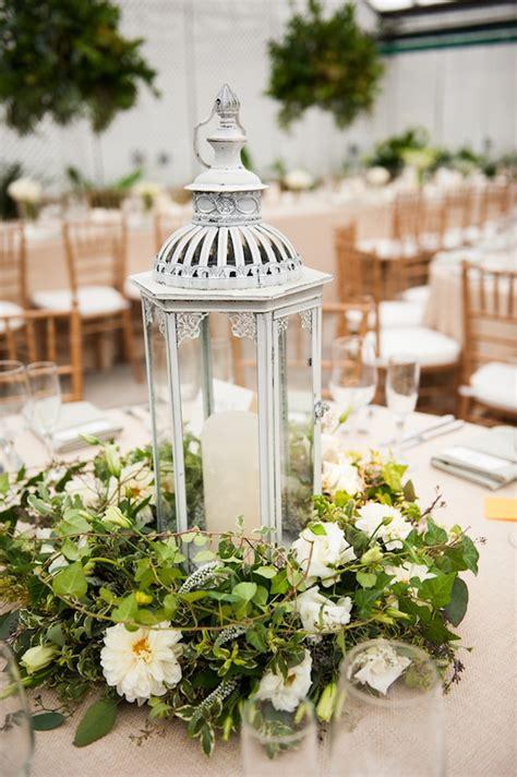 lantern table decorations weddings beautiful garden inspired lantern centerpiece flowers by beautiful blooms photo by lorraine