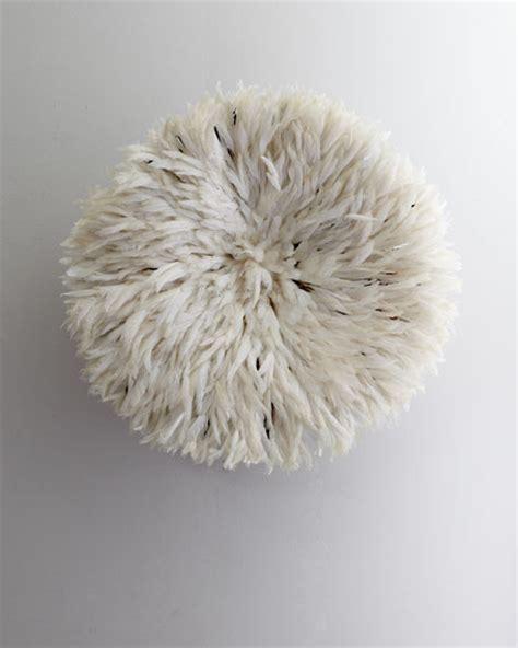 white feather headdress wall decor