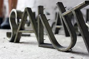 an assortment of c1940 cast metal letters from the With cast metal letters