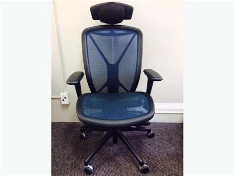 blue office chair with neck rest city