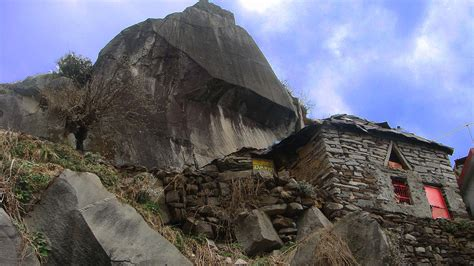 A Small Brick House On Top Of A Mountain Photograph By Gili Hg