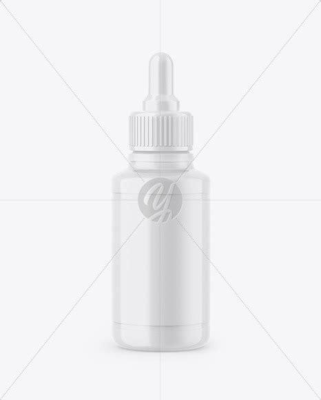Online mockup generator template for an amber glass dropper bottle label. Glossy Dropper Bottle Mockup in Bottle Mockups on Yellow ...
