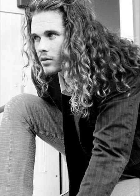 Hairstyles for men with long hair like this are ideal for anyone who has curly textured hair that wants to grow it out while still having a fun and current look. 50 Long Curly Hairstyles For Men - Manly Tangled Up Cuts