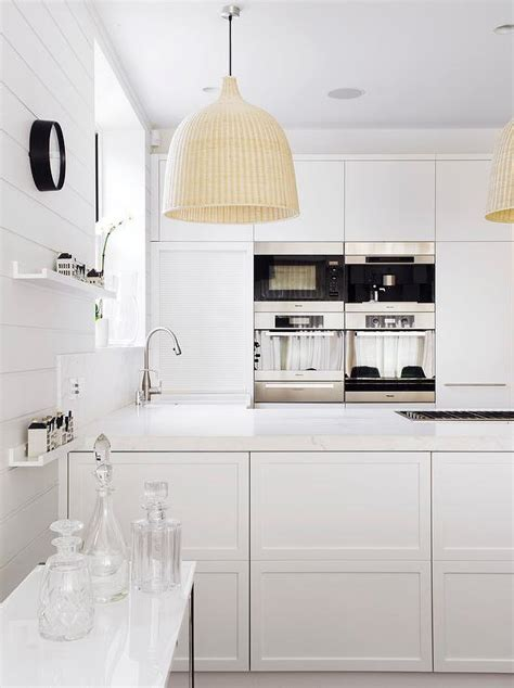 white modern kitchen  ikea light pendants modern kitchen