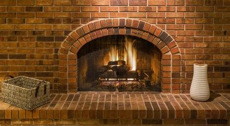 indoor outdoor fireplaces brick vs fireplace pros cons comparisons and costs