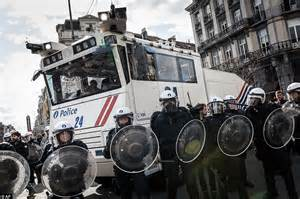 Riot police use water cannon on the streets of Brussels ...