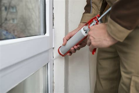 caulking gun how to insulate windows bob vila