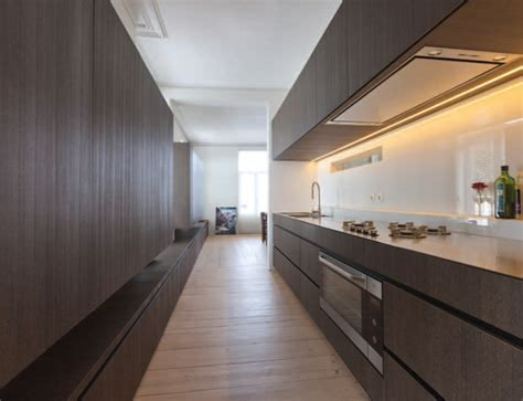 Long kitchen with extra long bench by Belgian architect
