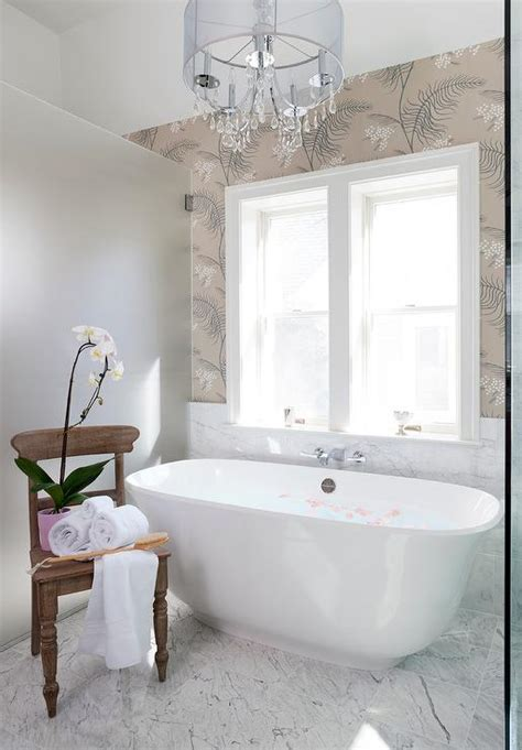 wall mount tub filler  marble wall transitional bathroom
