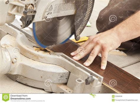 Cut Laminate Flooring With Circular Saw by Contractor Using Circular Saw Cutting Of New Laminate