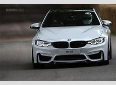 BMW M4 in Alpine White drifts for spectators at Goodwood