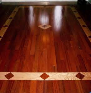cherry hardwood floor with a oak inlay design great design for an enterance way