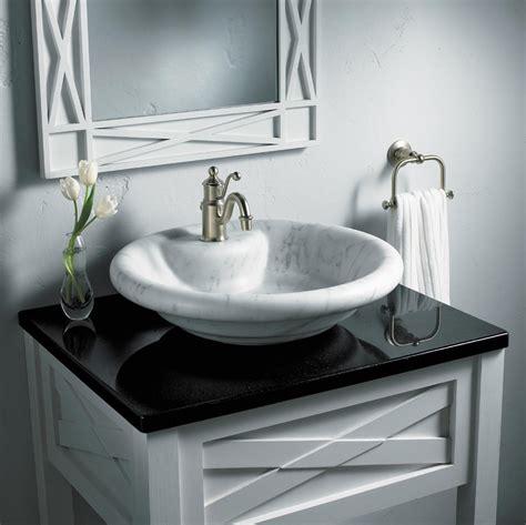 black bathroom countertops  marble vessel sinks