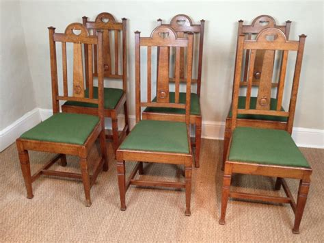 a set of 6 oak arts and crafts dining chairs c 1900
