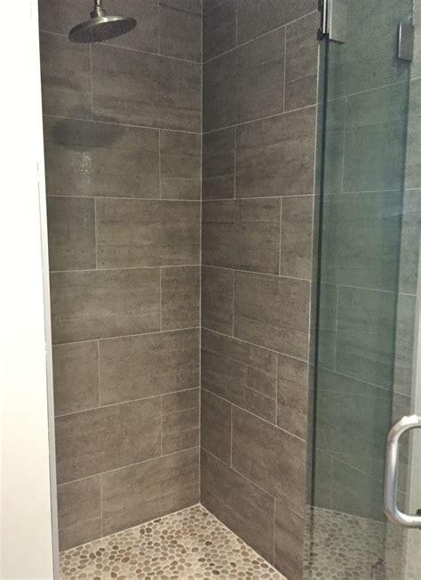 Master Shower: 12x24 porcelain tile on walls, pebbles on