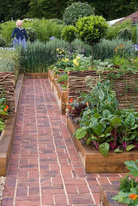 beautiful vegetable garden pictures brick path through beautiful raised bed vegetable gardens wheat growing along the edge willow