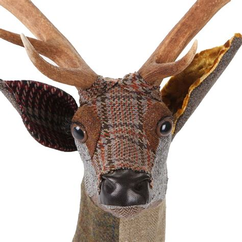 Let friends and family be impressed with your sense of style and love for art as you gently place our range of animal figurines in your home décor. Buy Carola van Dyke Fabric Arthur Sika Deer Head Wall Hanging   Amara