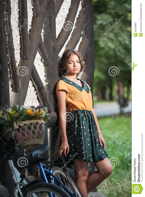 Beautiful Girl Wearing A Nice Dress With College Look