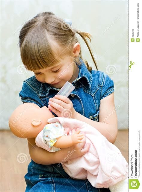 Girl Playing With Doll Stock Photo Image Of Affectionate