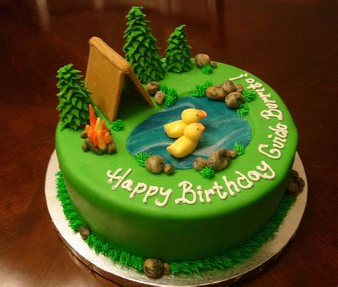 green  camping theme cake  pond  ducks