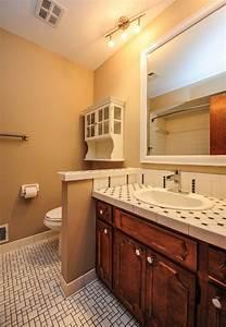 Vanity And Knee Wall Separating Toilet