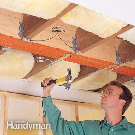 Suspended Ceiling Joist Hangers by How To Install A Load Bearing Beam The Family Handyman