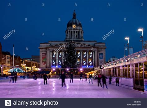 nottingham town hall with christmas lights and ice rink