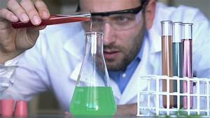 Scientist Doing Science Experiment In Laboratory Stock