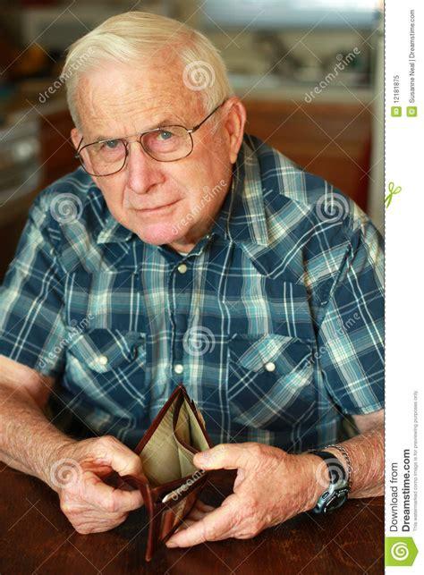 senior mans empty wallet royalty  stock photo image