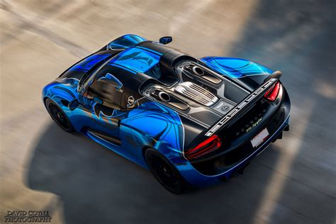 blue  black porsche  spyder oct