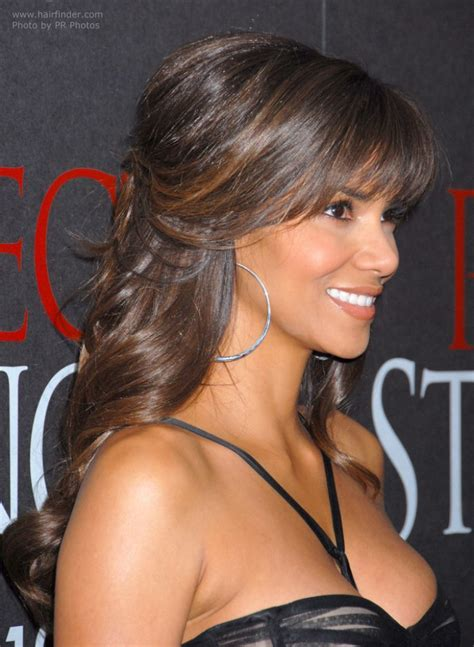 Halle Berry's hairstyle with curls that cascade down her back