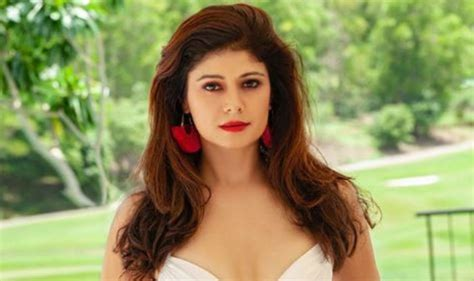 Pooja Batra Flaunts Her Perfectly Toned Abs In White