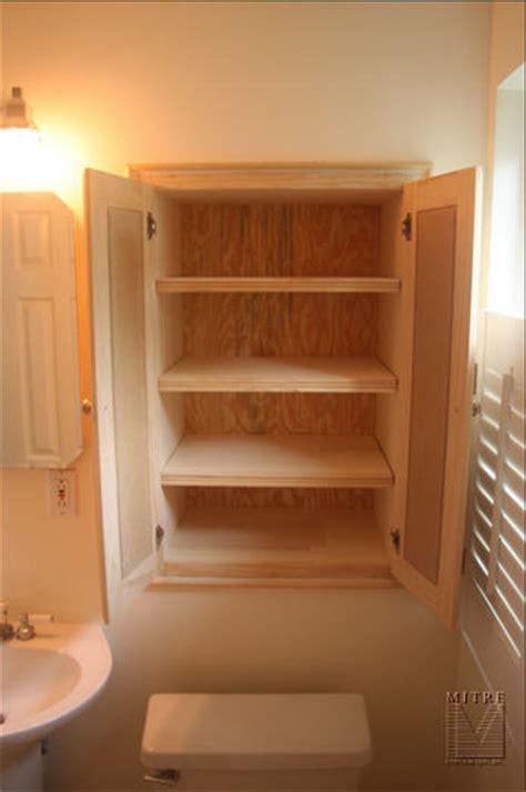 bathroom built  niche cabinet mitre contracting