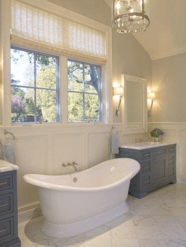 traditional tub traditional bathroom with grey blue vanities and stand