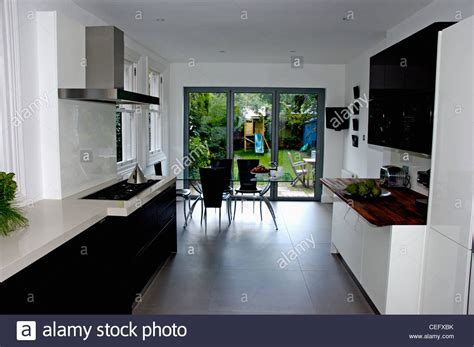 modern kitchen flooring modern white kitchen dining room with black flooring and 4215
