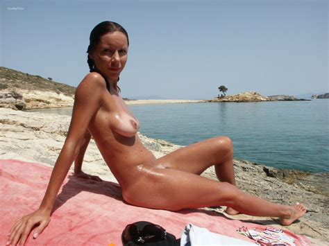 Slim and beautiful sun kissed wife vacation... Full-size image #1