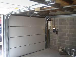 portes de garage menuiserie pvc alu bois yannis With video montage porte de garage sectionnelle