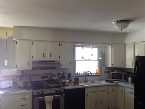 Small Kitchen Redo Ideas - remove bulkhead above cabinets leave just a section over sink