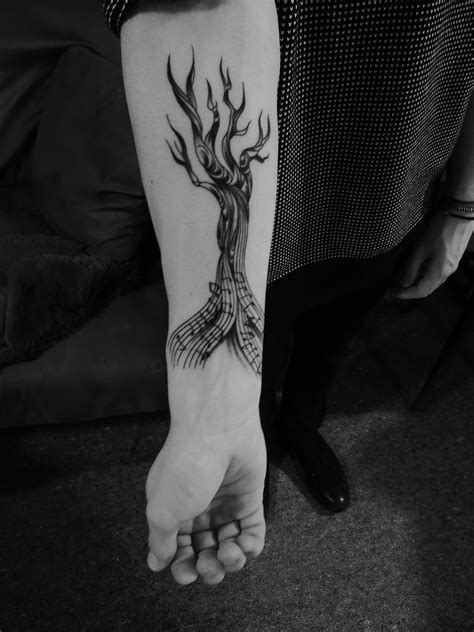 very cool tattoo, tree made of music | Back tattoo, Forearm tattoo men, Forearm tattoos