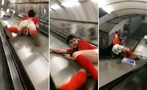see it drunken sports fan slides escalator