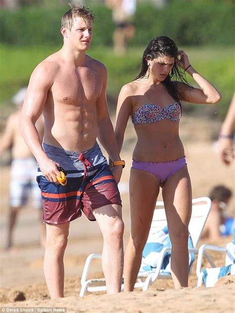 Alexander Ludwig tosses model girlfriend in the air in ...