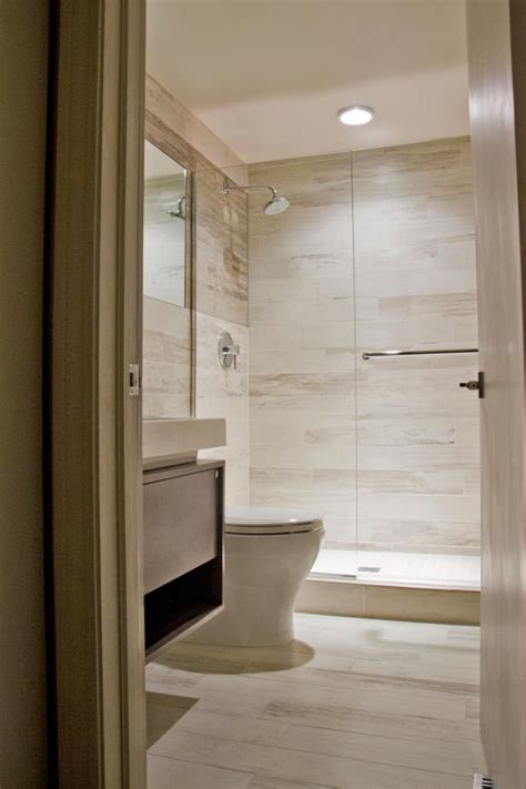 neutral modern bathroom with glass enclosed shower hgtv